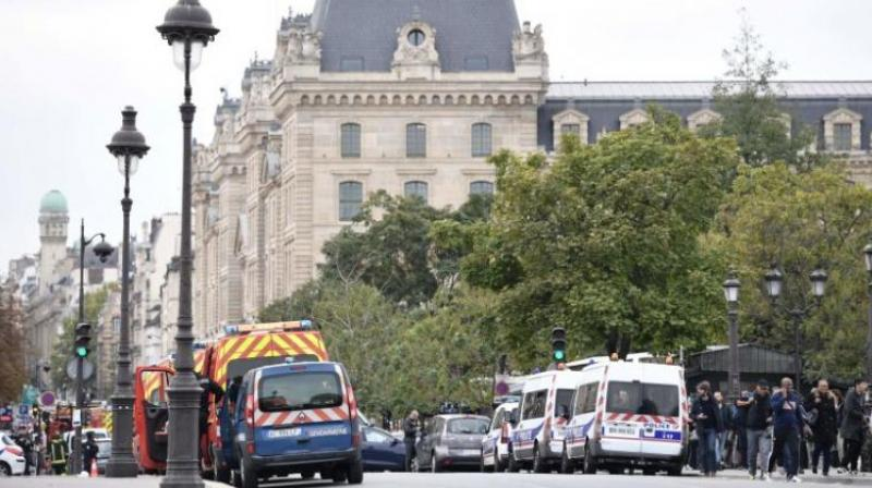 The attacker worked at the police building in an administrative capacity. (Photo: AFP)