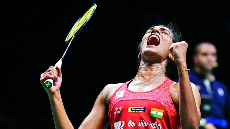 P. V. Sindhu celebrates her victory over Nozomi Okuhara in the women's singles quarterfinals.
