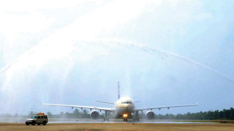 The Jeddah-Kozhikode Saudi Airlines flight gets a customary water salute on Wednesday.