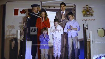 When in Rome: Trudeau and his family fold hands in the traditional 'namaste' on reaching India. (Photo: AP)