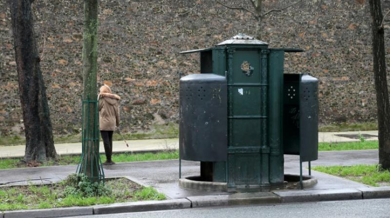 "An attempt last year to revive ""pissoirs"" on the streets of Paris to stop men from urinating against walls. (Photo: AFP)"