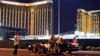 At least two people died early on Monday and 26 were hospitalised with suspected gunshot wounds after a shooting at a music festival on the Las Vegas Strip.