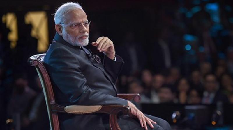 Talkative in foreign, 'mauni baba' in India: Shiv Sena denounce PM Modi