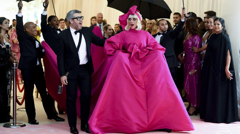 Lady Gaga's former stylist Nicola Formichetti is the person behind the outstanding ensemble for the exhibition. (Photo: AP)