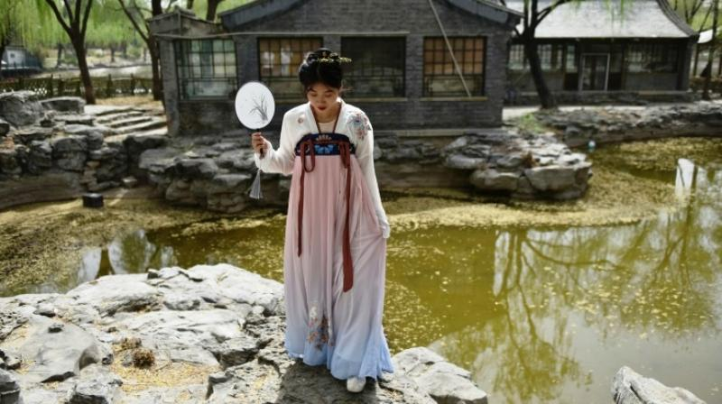 These historic costumes of the Han ethnic majority are enjoying a renaissance in part because the government is promoting traditional culture in a bid to boost patriotism and national identity. (Photo: AFP)