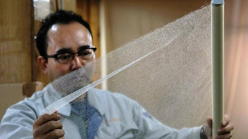 Washi naturally fits into intricately-shaped sculptures, but papers with chemical fibres or wrapping films don't. (Photo: AFP)