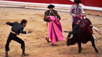 Leonardo Hernandez, left, performs during a bullfight at San Fermin Fiestas, in Pamplona, northern Spain. (Photo: AP/ Alvaro Barrientos)