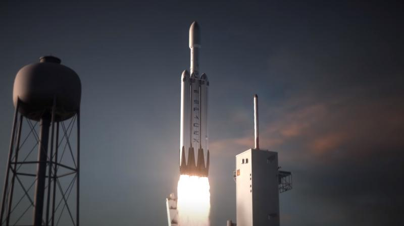 The Falcon Heavy won't surpass NASA's Saturn V moon rocket, still all-time king of the launch circuit.  (Photo: SpaceX)