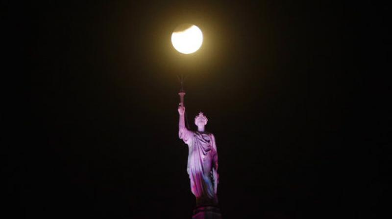 The moon put on a rare cosmic show Wednesday: A red blue moon, super big and super bright. Several places around the world witnessed a spectacular show put up by our own celestial body.