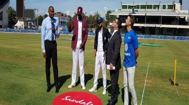 West captain Jason Holder and Indian captain Virat Kohli stand together for the toss. (Photo: BCC/Twitter)