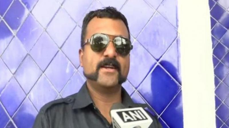 Speaking to ANI, the policeman said instead of following the latest trends and copying 'fake heroes' like film stars, he chose to copy Abhinandan's style. (Photo: ANI)