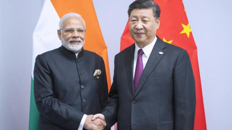 Modi to host Xi at summit with ties strained by occupied Kashmir