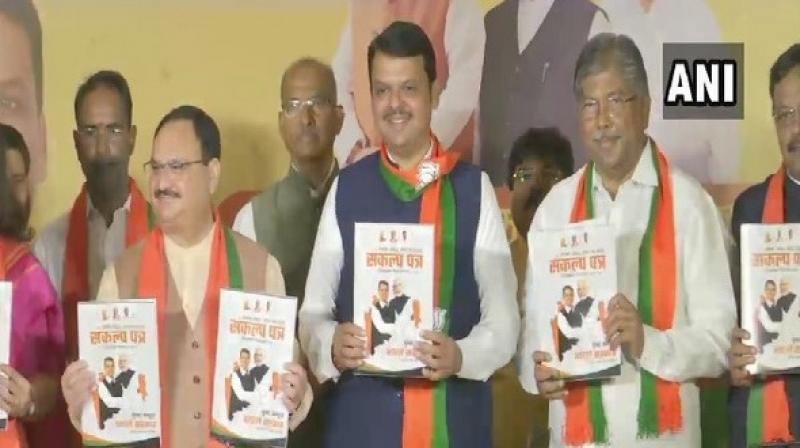 BJP Working President J P Nadda and Maharashtra CM Devendra Fadnavis releasing part manifesto. (Photo: ANI)