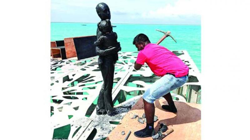 Jason deCaires Taylor's sculpture being destroyed with pickaxe after outgoing Maldives president Abdulla Yameen ruled it was offensive to Islam.