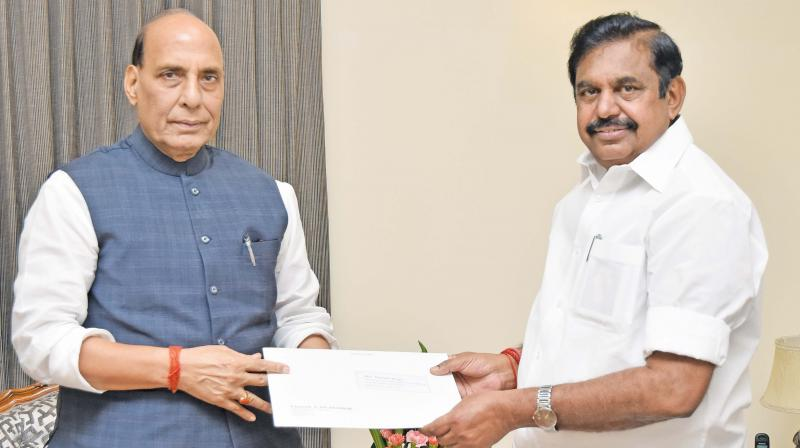 Chief Minister Edappadi K. Palaniswami meets home minister Rajnath Singh at Raj Bhavan and gives him a memorandum on Tuesday.