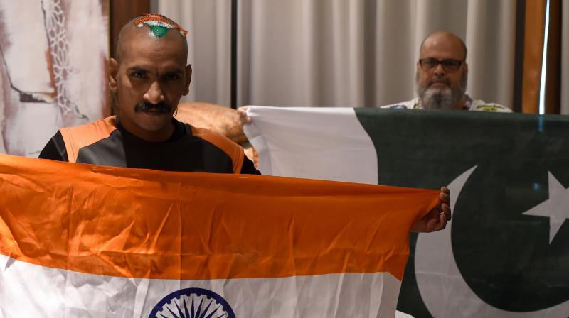 Their governments might not be ready for talks, but that did not stop Pakistan's Mohammad Basheer opening his heart, and his wallet, to ensure India's most recognised cricket fan Sudhir Chaudhary, also known as Sudhir Kumar Gautam, could be at the Asia Cup. (Photo: AFP)