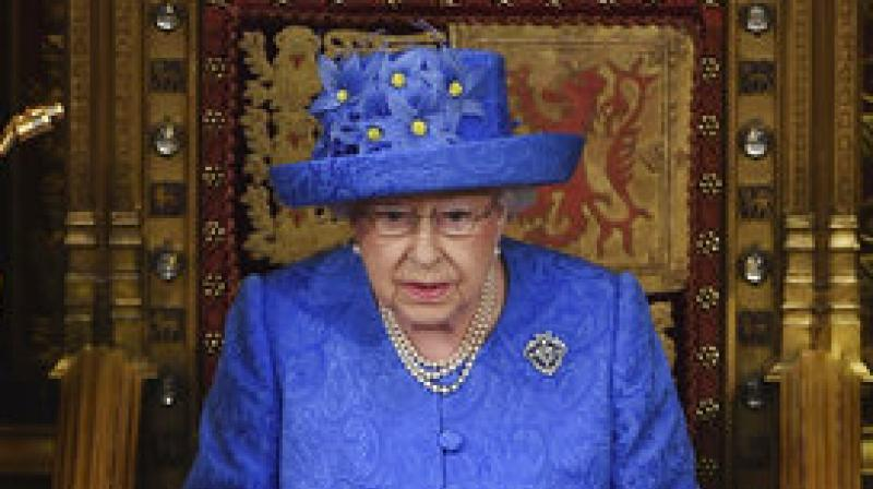 The queen, at an occasion shorn of its usual pageantry, read out the watered-down list of proposed legislation and lawmakers will then spend the next few days debating before bringing it to a vote. (Photo: AP)
