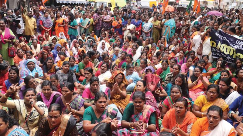 Members of the BJP's Mahila Morcha stage a protest in front of Travancore Devaswom Board office against the Supreme Court verdict allowing women of all ages to enter Sabarimala temple, in Thiruvananthapuram on Thursday. (Photo:Thinkal Kumar)