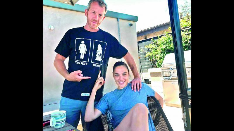 Gal Gadot's husband, Yaron Varsano, shows off his t-shirt.