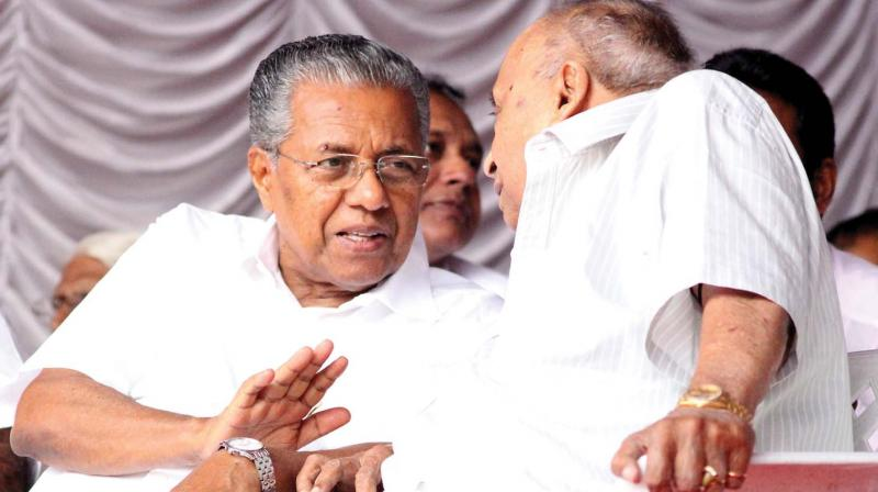 Chief Minister Pinarayi Vijayan interacts with M.P. Veerandra Kumar, MP, during the LDF public convention at Muthalakulam, Kozhikode on Tuesday  	(Photo: Venugopal)