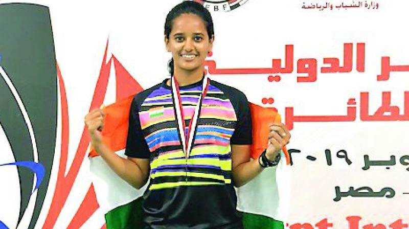 Sri Krishna Priya poses with the Indian flag and her medal after the presentation ceremony of the Egypt International Badminton tournament in Cairo on Sunday.