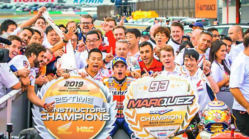 Marc Marquez poses with Team Honda after winning the Premier Class Constructors Championship on Sunday.