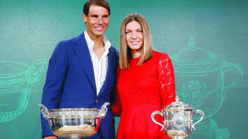 Defending  champions Rafael Nadal and Simona Halep during the draw of the French Open in Paris. (Photo: AP)
