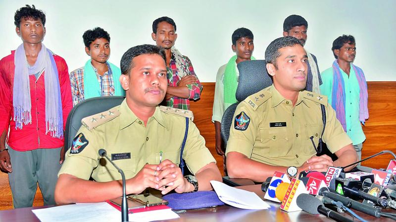 East Godavari district SP Vishal Gunni produces before media the militia members who surrendered in Kakinada on Monday. (Photo: DC)