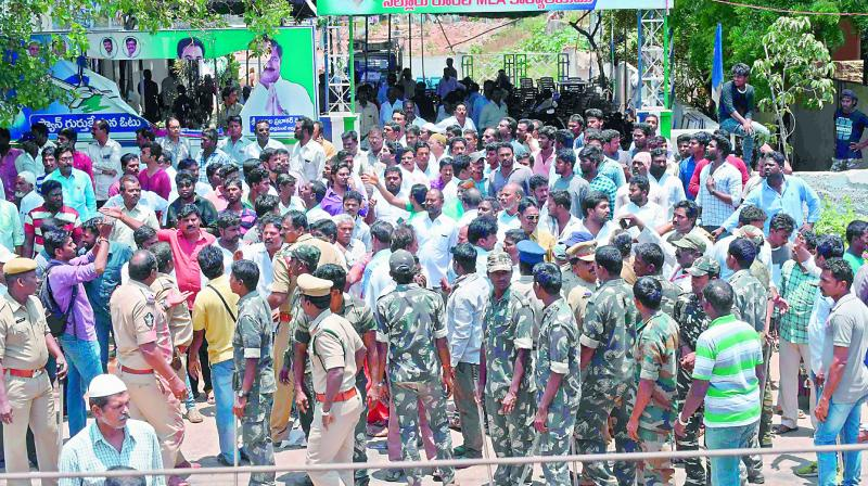 Police stand outside Nellore rural YSRC legislator Kotamreddy Sridhar Reddy's office following a protest by TD cadres in front of the office at Nellore on Monday. (Photo: DC)