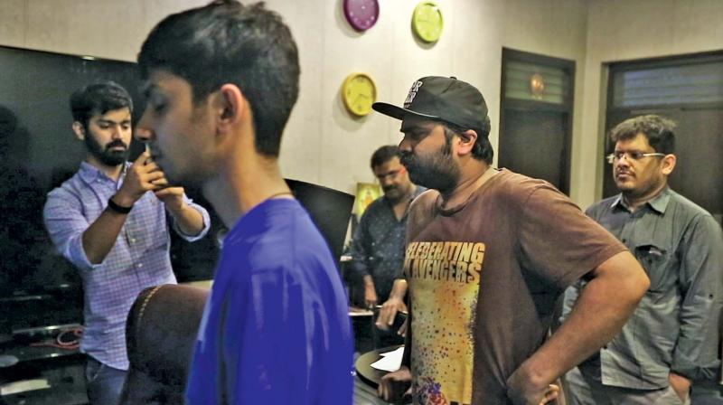 Anirudh and STR at the recording of the song.