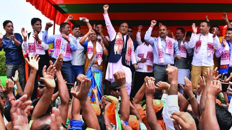 BJP leader Himanta Biswa Sarmah dances with the crowd during an election campaign rally at Bahjani in Nalbari district of Assam on Tuesday in support of the party candidate Dilip Saikia of Mangaldoi parliamentary constituency (Photo: AP)