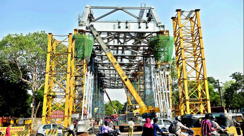 The temporary iron pillars erected at Chilkalguda circle to move the Oliphant steel bridge for the Hyderabad Metro Rail.—DC