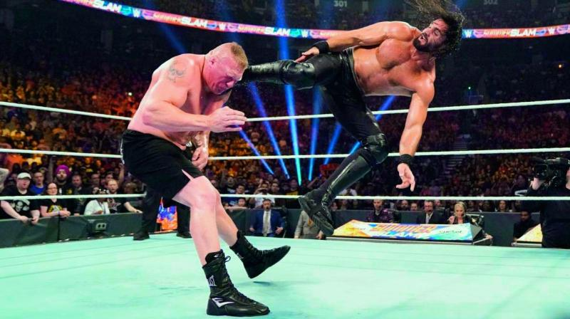 Seth Rollins (right) launches into a flying kick on Brock Lesnar during their WWE Universal Championship fight at the Scotiabank Arena in Toronto on Sunday.  (Photo: WWE.com)