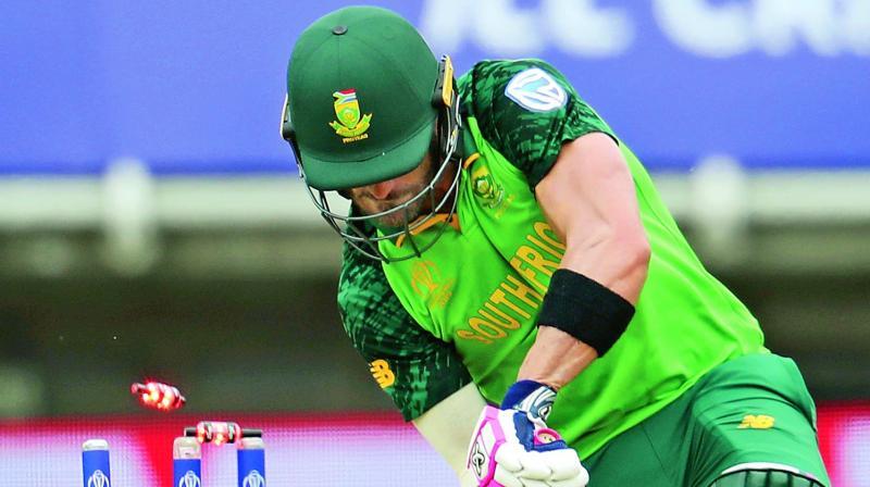 Faf du Plessis  is bowled by Lockie Ferguson. (Photo: AFP)