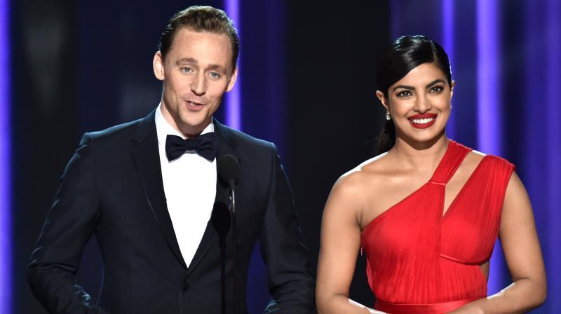 Priyanka Chopra with Tom Hiddleston on the Emmy Awards stage in 2016. (Photo: AP)