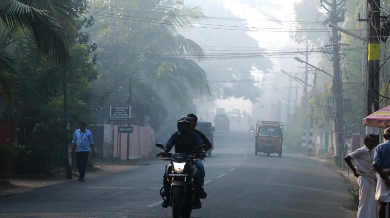 Fog enveloped many parts of Kochi on Saturday morning after smoke emanated from the waste dump at Brahmapuram waste processing plant even 17 hours after the fire.   (ARUN CHANDRABOSE)