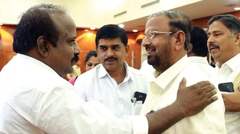 Deputy mayor T.J. Vinod greets Opposition leader K.J. Antony after presenting the Kochi corporation's budget for 2019-20 on Saturday.  (ARUN CHANDRABOSE)