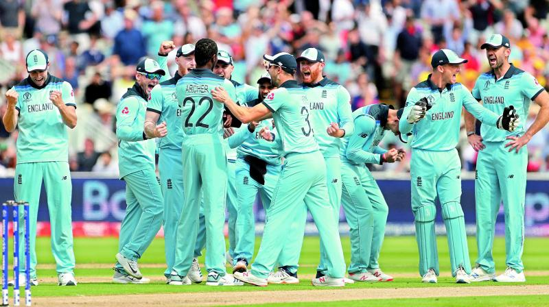 England players are jubilant as they celebrate the dismissal of Australian captain Aaron Finch during the semifinal at Edgbaston in Birmingham on Thursday. England won the match by eight wickets. (Photo: AP)