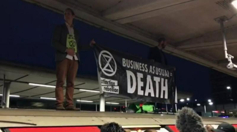 Climate activists took to roofs of trains in London. (Photo: AP)