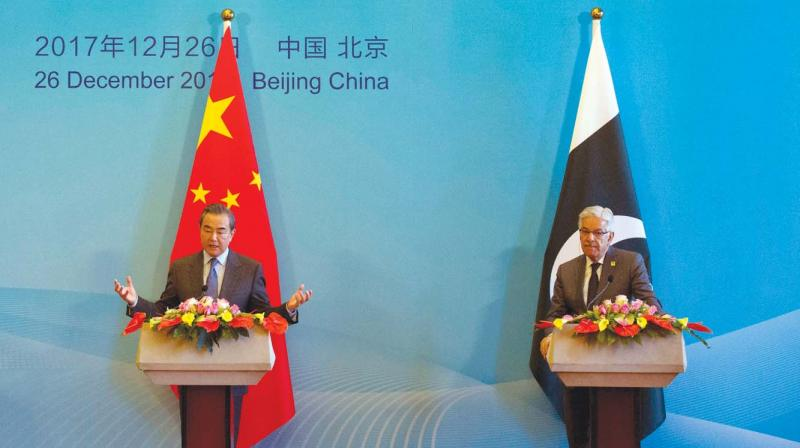 Chinese foreign minister Wang Yi flanked by his Pak counterpart Khawaja Asif at the 1st China-Afghanistan-Pakistan Foreign Ministers' meet.