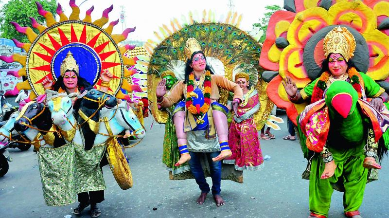 Eluru-based folk artistes perform during the annual festival of local Goddess Kanakadurga Ammavaru at Isukathota junction in Visakhapatnam on Tuesday.(Photo: DC)