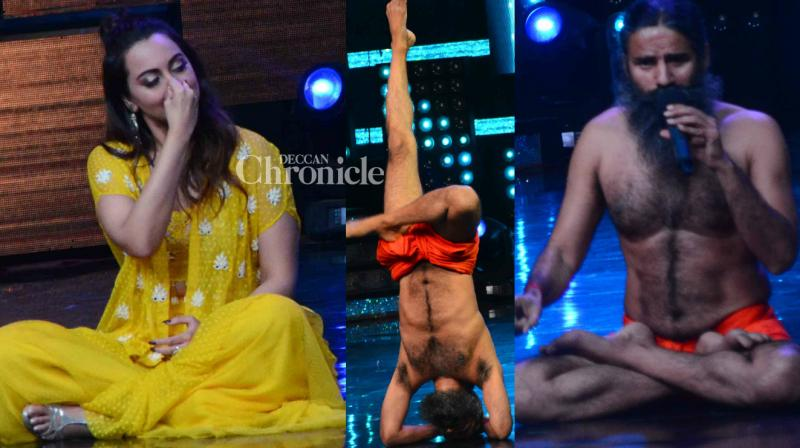 Baba Ramdev was a guest on the reality show 'Nach Baliye where he performed his yoga asanas and also got the judges on the show including Sonakshi Sinha doing them as he shot for the episode in Mumbai on Tuesday. (Photo: Viral Bhayani)