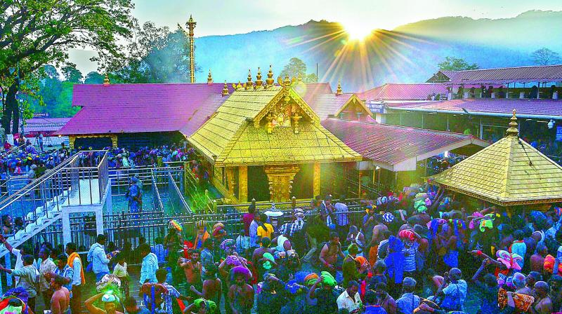 A large number of Lord Ayyappa devotees climbed the sacred 18 steps and offered prayers on the initial day, a TDB release said. (Photo: PTI)