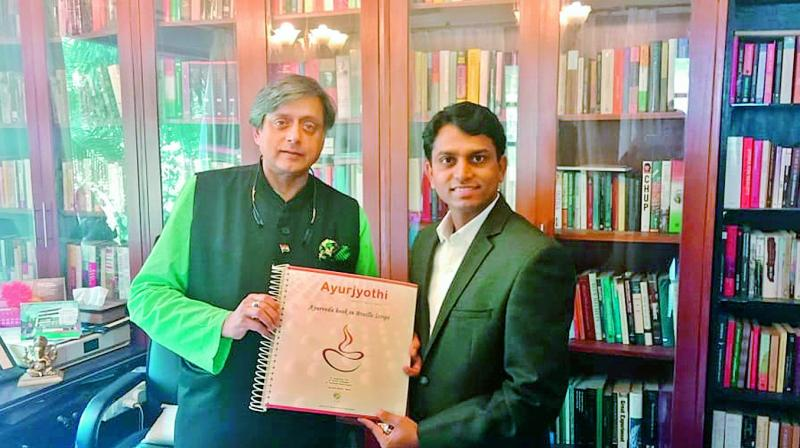 Former Union minister Shashi Tharoor releases the second  edition of Ayurjyothi in Braille. Author of the book Dr Anil Kumar Puli, a native of Warangal, is also seen.  (DC)