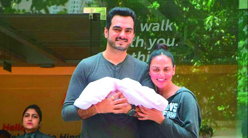 Esha Deol and her husband were photographed exiting the hospital with gleaming smiles.