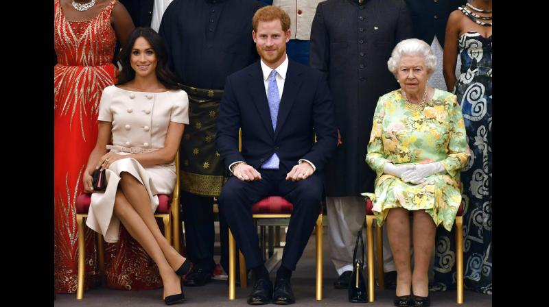 Markle and Prince Harry were accompanying Queen at annual ceremony which champions inspirational young people from across Commonwealth. (Photo: AP)