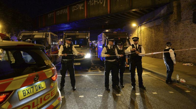 Police officers man a cordon at Finsbury Park where a vehicle struck pedestrians in London Monday. (Photo: AP)