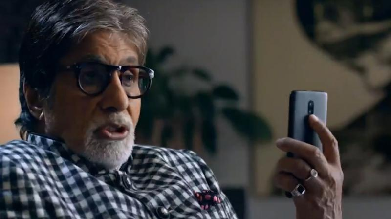 What is Amitabh Bachchan hiding in OnePlus 6T teaser ad?