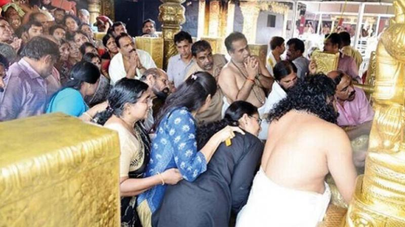 The photograph circulating in social media of women in the prohibited age group in the sanctum sanctorum of the Sabarimala Ayyappa temple recently. (File photo)