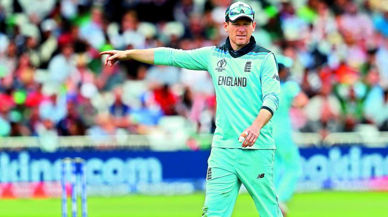 England captain Eoin Morgan directs teammates to their fielding positions during the match against Pakistan. (Photo: AP)